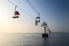 Early in the morning, stationary Tram on the sea. Early in the morning, an attractions in the Bohai Bay, the cable car quietly waiting for the arrival of Royalty Free Stock Image
