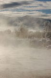 Early Morning Steam on the River. Steam rises one chilly winter morning in Steamboat springs, Colorado Royalty Free Stock Image