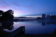 Early Morning Stillness. At a lake Stock Photo