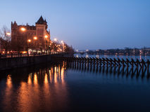 Early morning with street lamps on Smetana Embankment at Vltava River in Prague Royalty Free Stock Images