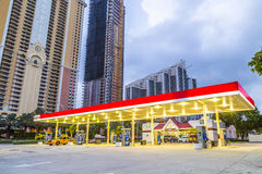Early morning streetview in Sunny isles beach with petrol station Royalty Free Stock Image
