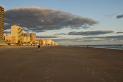 Early Morning Stroll. People walking early morning daytona beach florida looking north Royalty Free Stock Image