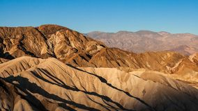 Early morning of summer at Zabriskie Point, Death Valley National Park, California. Mudstone and claystone badlands of Zabriskie Point in early morning in summer Stock Image