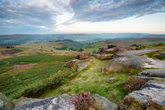 Early Morning at Higger Tor. Early morning on the summit of Higger Tor in the Peak District and looking out towards Hope Valley in the distance royalty free stock image