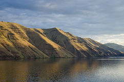 Early Morning Sun Rising Across Hells Canyon Stock Image