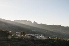Early morning sun spotting on a mountain village Royalty Free Stock Images