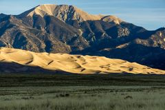 Great Sand Dunes National Park and Preserve. Early morning sunlight on the famous dune field near Alamosa, Colorado Stock Photos