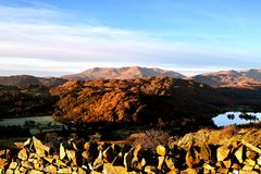 Sunlight on the Loughrigg Fell. Early morning sunlight over the Coniston Fells Royalty Free Stock Photo