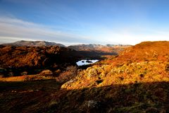 Sunlight on the Loughrigg Fell. Early morning sunlight over the Coniston Fells Stock Photography