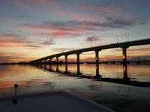 Early morning sunrise. By boat glassy waters stock photography