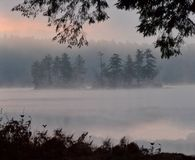 Early Morning Sunrise and Fog on Highland Lake, Bridgton, Maine July 2012 by Eric L. Johnson Photography Stock Photos