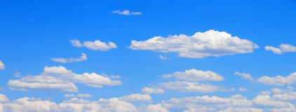 White clouds with Blue sky. White clouds drifting across a bright blue sky Royalty Free Stock Photos