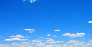 White clouds with blue sky. White Clouds drifting across a bright blue sky royalty free stock photography