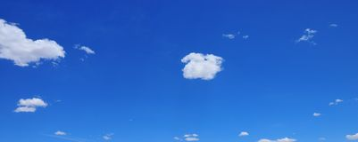 White clouds with Blue Sky. Clouds drifting across a bright blue sky stock images