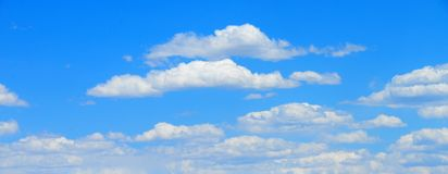 White clouds with Blue sky. White clouds drifting across a bright blue sky royalty free stock image
