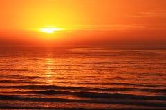 Early Morning Sunrise On Ocean Stock Photo