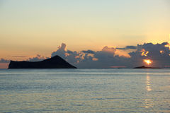 Early Morning Sunrise over Waimanalo Bay over Rock Island bursti Royalty Free Stock Photo
