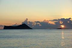 Early Morning Sunrise over Waimanalo Bay over Rock Island bursti Royalty Free Stock Photo