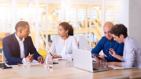 Early morning sunrise performance evaluation meeting with four business partners Stock Photos