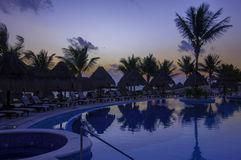 Early Morning Sunrise by the pool at a cancun resort Stock Photo