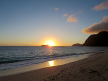 Early Morning Sunrise on Waimanalo Beach over Rabbit Island burs Stock Photography