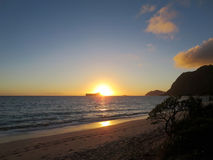 Early Morning Sunrise on Waimanalo Beach over Rabbit Island burs Stock Photo
