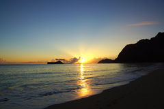 Early Morning Sunrise on Waimanalo Beach over Rock Island bursti Royalty Free Stock Image