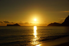Early Morning Sunrise on Waimanalo Beach over Rock Island Stock Images