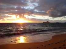 Early Morning Sunrise on Waimanalo Beach with sunlight reflectio Royalty Free Stock Photography