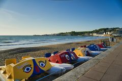 Swanage Pedalos. Early morning Swanage pedalos lined up on beach royalty free stock photography