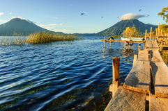 Early morning & three volcanoes, Lake Atitlan, Guatemala Royalty Free Stock Photos