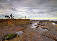 Early morning at a tidal pool. Amazing place to park your bike and enjoy the view of the ocean stock photos