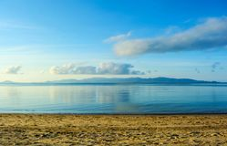 Early morning sky above island and the sea scenic. EARLY MORNING TIME SCENIC BEFORE SUNRISE  AT SEASIDE , FAR AWAY RANGE ISLAND VIEW IN OCEAN ,BLUE SKY ABOVE SEA Royalty Free Stock Photography