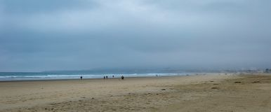 Early Morning Mist at the Beach. Early morning at the uncrowded San Diego California beach with a gray sky and misty atmosphere is calming and serene stock photography