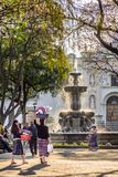 Early morning vendors in central plaza, Antigua, Guatemala. Antigua, Guatemala - March 30, 2018: Early morning vendors, locals & tourists on Good Friday in stock photo