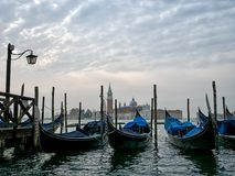 Gondolas and San Giorgio Maggiore, Venice, Italy. Early morning view across the lagoon Royalty Free Stock Photography
