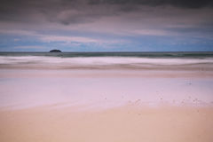 Early morning view of the beach at Polzeath Vintage Retro Filter Royalty Free Stock Images