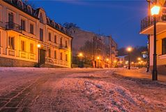 An early morning view of colourful buildings on empty Andriyivskyy Uzvoz Descent or Spusk. One of the oldest street in Kyiv.  stock photos