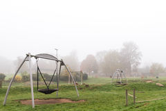 Early morning view of empty playground with fog around it Royalty Free Stock Photos