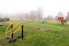 Early morning view of empty playground with fog around it Royalty Free Stock Photo