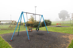 Early morning view of empty playground with fog around it Royalty Free Stock Images