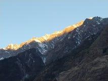 Golden line on snow mountain stock photos
