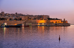 The early morning view of the Grand Harbour Port of Valletta. The early morning view of Valletta and the Grand Harbour Port of Valletta on Malta Stock Photography