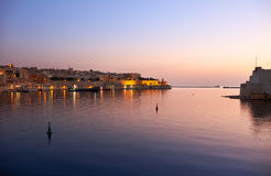 The early morning view of the Grand Harbour Port of Valletta. The early morning sunrise view of Valletta and the Grand Harbour Port of Valletta on Malta Stock Photo