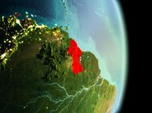 Guyana in morning from orbit. Early morning view of Guyana highlighted in red on planet Earth. 3D illustration. Elements of this image furnished by NASA Stock Image