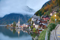 Early morning view of Hallstatt with beautiful reflections on smooth lake water stock photo