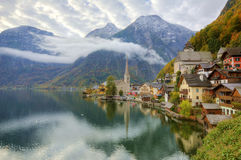 Early morning view of Hallstatt with reflections on lake water Stock Photography