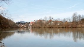 City of Fuessen, Germany. Early morning view on the historical part of the city of Fuessen, Germany, as seen from across the river Lech from the south stock footage