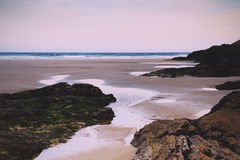 Early morning view over the beach at Polzeath Vintage Retro Filt Stock Photo