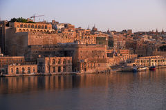 The early morning view of Valletta fortifications from the water Royalty Free Stock Image